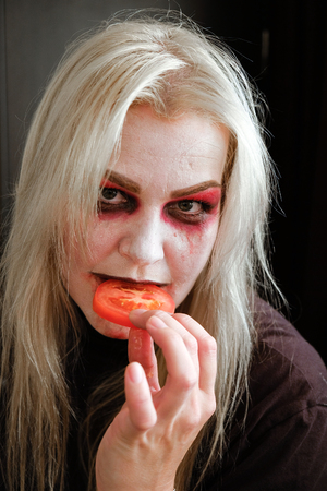 zombie girl with black eyes and a bloody mouth on Halloween