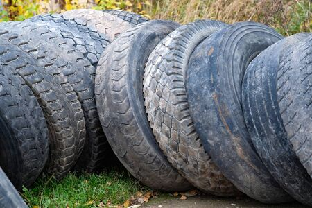 a lot of used tyres lay on a dump Stock Photo
