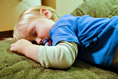 the baby sleeps on the couch Stock Photo