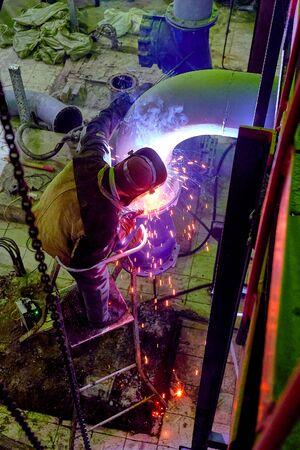 the welder welds metal structures