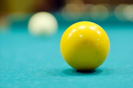 a billiard ball on a pool table green cloth