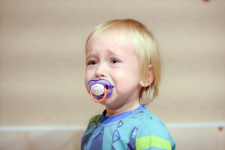 cranky baby cries Stok Fotoğraf