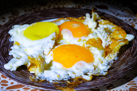 eggs are fried in a frying pan Stock Photo