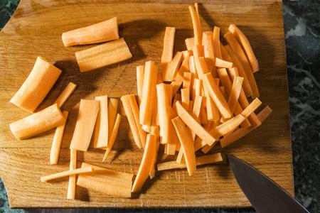 fresh sliced carrots on a wooden chopping Board Reklamní fotografie