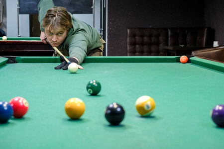 the player takes aim at the ball in Billiards Reklamní fotografie