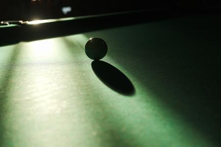 billiard ball in the rays of light on the billiard table