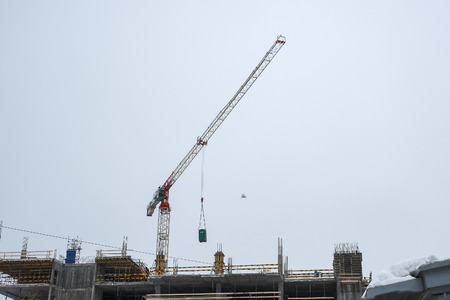 the high crane at a construction site