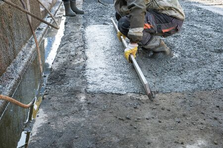 builders poured concrete at the construction site