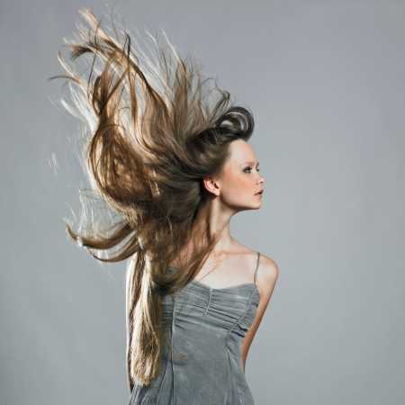 Beauty model in studio with hair blown by wind Stock Photo - 17495621