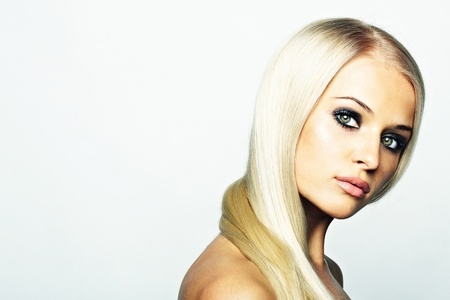 Sensual woman model with shiny straight long blond hair and photo