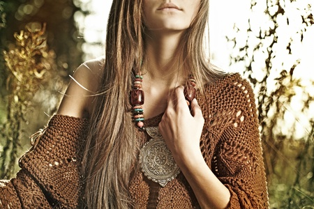 spring fashion: trendy look of a beautiful, mysterious girl in forest, mother preroda, fashion spring autumn Stock Photo