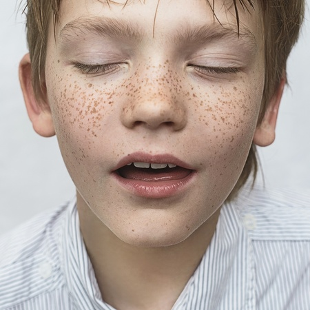 portrait of a handsome boy with freckles, art close-up portrait photo