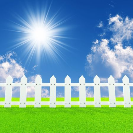 white fence on a summer lawn in a sun day Standard-Bild