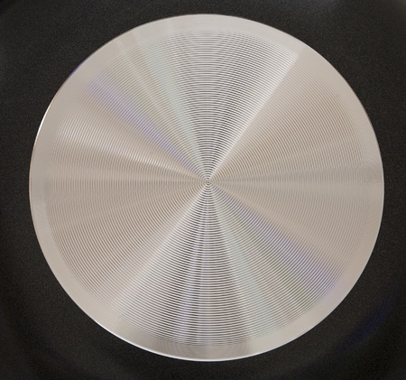 brushed metallic surface with patches of light as a background Stock Photo - 8698439