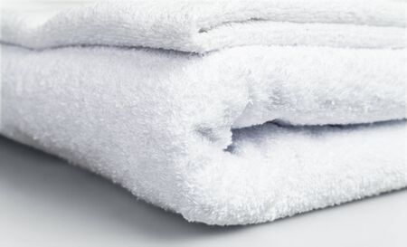 Some white towels in a pile