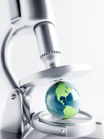 Researching of earth globe under magnification with microscope Standard-Bild