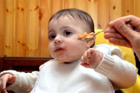baby feeding by mom