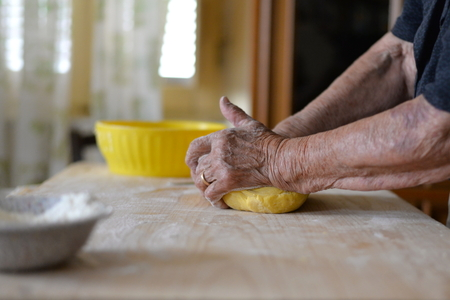 making a fire: grandmother making italian homemade pasta for pizza