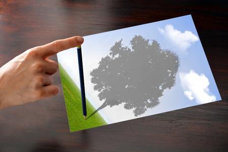 optimist: tree shadow on paper sheet of optimist woman project