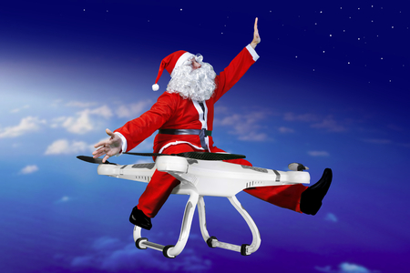 robot toy: snata claus flying on drone Stock Photo