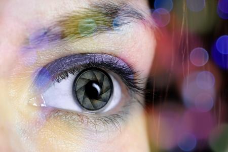 photography: photography concept of eye camera lens
