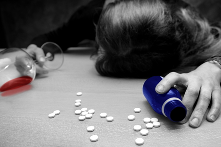 suicidal: deadly drugs cocktail token by suicidal young woman Stock Photo