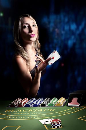 sexy gambler woman playng at blackjack casino table Stock Photo