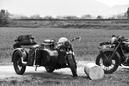 Castegnato, Brescia, Italy - April 25 2019: Nazi Wehrmacht World War 2 BMW motorcycles during Italian liberation day and US Army commemoration