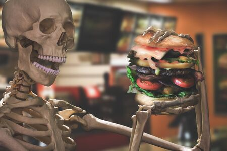 funny skeleton eating deadly junk food Banque d'images