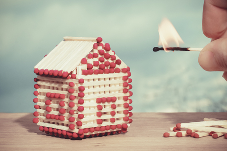 Model of a house of matches. Concept Stock Photo
