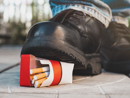 Intention to crush a pack of cigarettes. Stock Photo