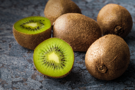 Kiwi fruit on a background of stone. Reklamní fotografie
