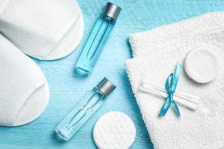 Personal hygiene items from a hotel set on a blue wooden background.