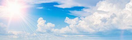 Bright sun in the blue sky with clouds panoramic view. 스톡 콘텐츠