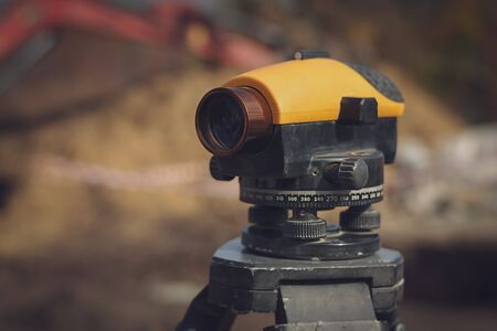 Close up optical level at construction site.