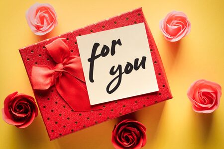 Red gift box with a note with the words