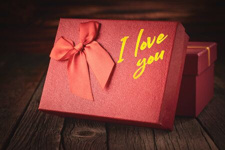 Close up of a red gift box with the words I love you on a wooden background: concept of a festive and romantic gift Stock fotó