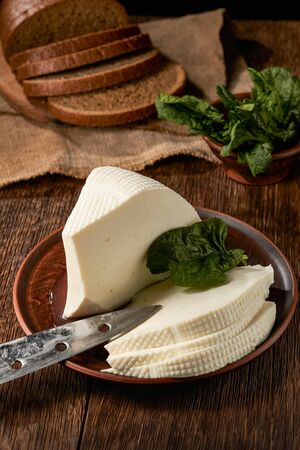 Homemade feta cheese sliced into slices and sliced bread on a board. Stock fotó