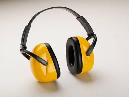 Headphones to protect hearing from noise on a light background. Reklamní fotografie