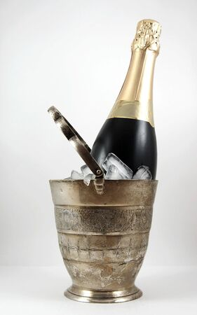 holydays: Champagne in an old silver bucket with ice Stock Photo
