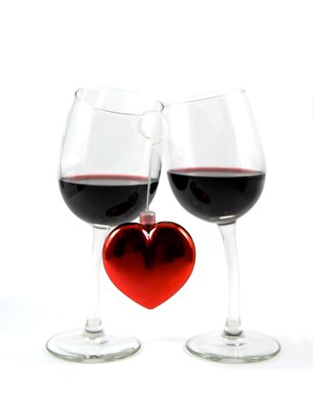 Two glasses with red wine and heart isolated over white background Stock Photo - 2525823