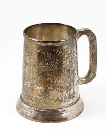 An old silver beer tankard. It is Eastern European  tankard decorated with ornament Stock Photo