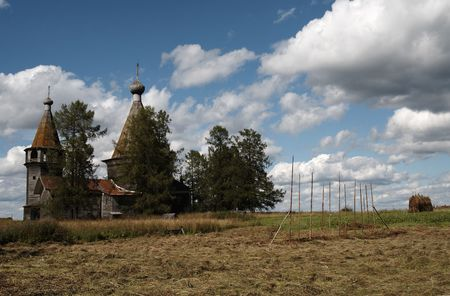 haymaking: Haymaking near wooden church in the north of Russia