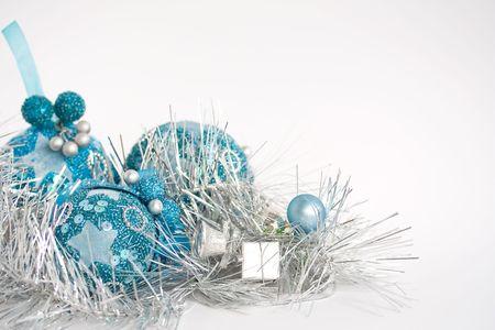 Blue christmas toys on white background photo
