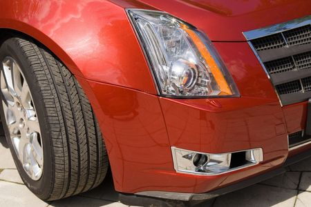 Red car headlight, front bumper and wheel Stock Photo - 5462335