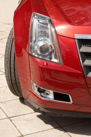 Closeup modern car headlight and fog lamp. Vertical image Stock Photo - 5462367