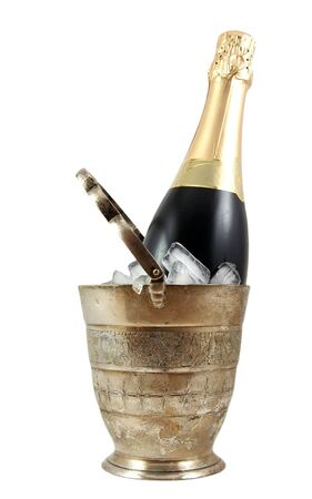 holydays: Bottle of champagne in old silver ice bucket isolated on white Stock Photo