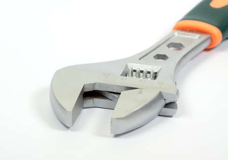 Macro shot of universal spanner with shadows on white background photo