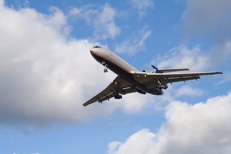 Passenger airplane landing on blue sky with clouds background Stock Photo - 9465396