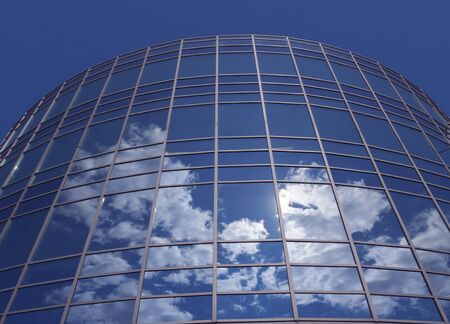 blue facades sky: Windows of skyscraper with reflections against blue sky